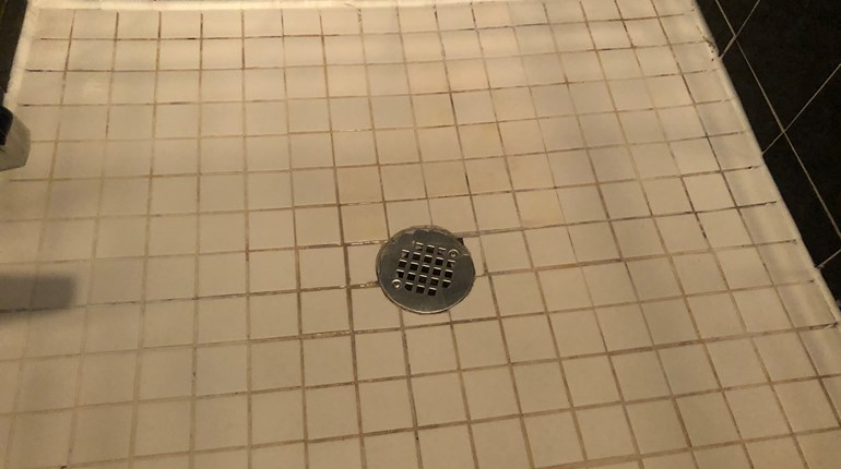 Clean up a clogged shower drain
